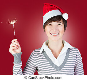 Smiling woman with sparkler