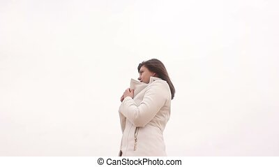 portrait woman girl in a coat on a white background autumn...