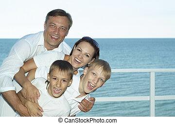 Happy family on ship