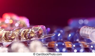 Top of syringe lays on different pills, rotation,...
