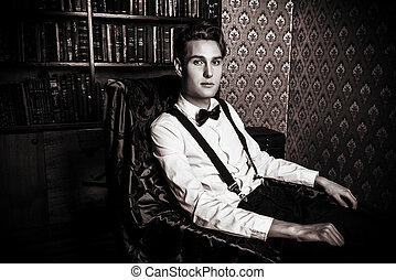 confidence - Elegant handsome young man sitting by the...