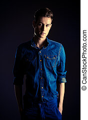 forceful look - Portrait of a handsome young man in jeans...