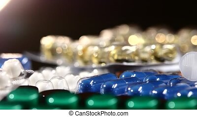 Needle of syringe lays on different pills, rotation,...