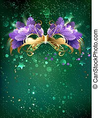 Mask on a green background - Mardi Gras mask of purple...