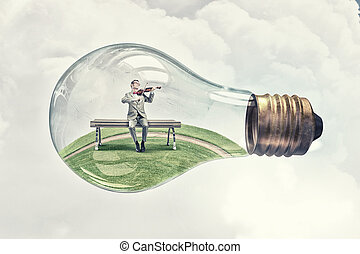 Inside of idea - Young businessman inside of glass light...