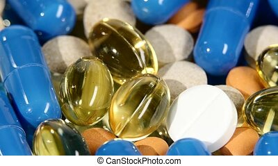 Colored medical pills, tablets and capsules, rotation, close up