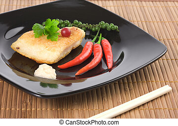 Served fried fish with chili pepper and horseradish souce