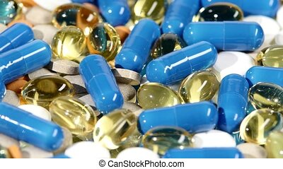 Medical pills, tablets and capsules, rotation - Colored...