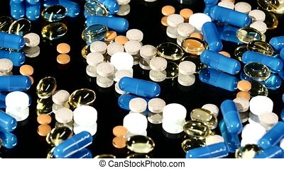 Medical tablets, pills and capsules, rotation, reflection -...