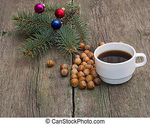fir-tree branch with jewelry, hazelnuts and a cup of coffee,...