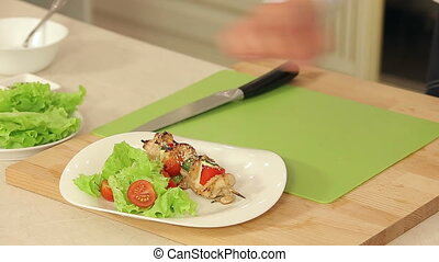 Chef is Putting Hot Grilled Kebab on a Plate With Salad HD