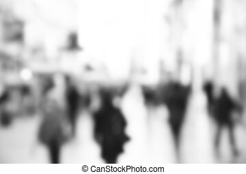 City commuters. High key blurred image of people walking in the street. Unrecognizable faces.