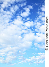 Blue sky with clouds - may be used as vertical background