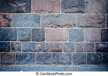 Wall of stone blocks and a side way