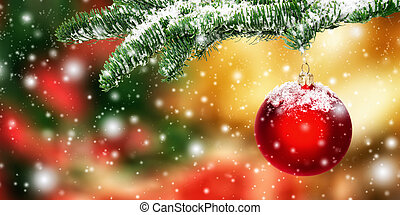 Hanging red Christmas bauble in snow