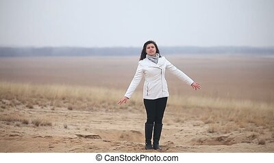 girl woman jumping nature in autumn nature sand - girl woman...