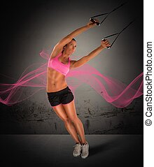Training with the TRX - Woman fitness instructor training...