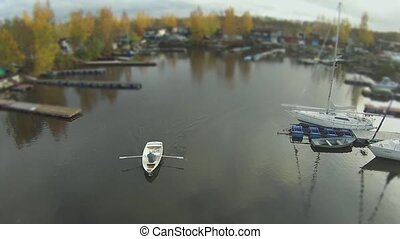 camera flying  over the rowing boat