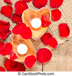 Two enlightened candles in heart-shaped candleholders -...