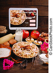 baking christmas apple pie with tablet pc - baking christmas...