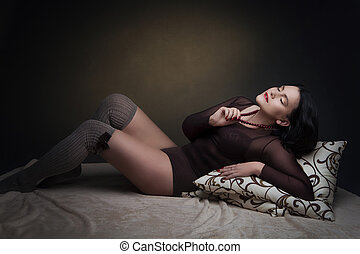 Beautiful young woman in brown body suit - Beautiful young...