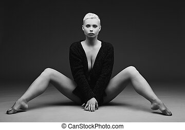 Beautiful young woman sitting with legs spread - Beautiful...