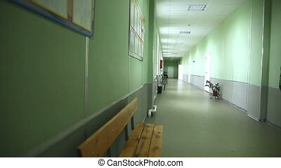 empty school corridor interior green wall to the right...
