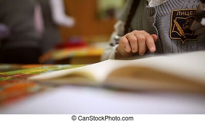 girl teen read book schoolgirl big hands sitting at desk in...