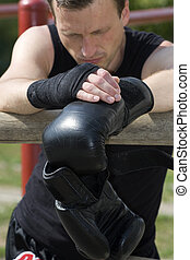 Kickboxer or muay thai fighter equips and trains outdoor -...