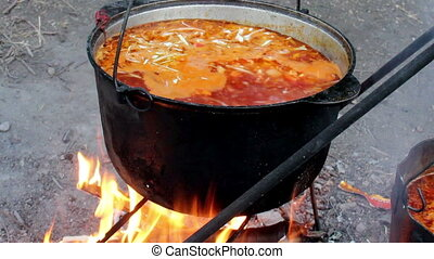 cooking red borsch - close-up cooking ukranian red borsch in...