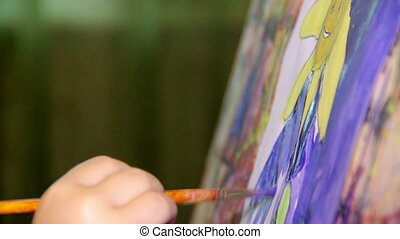 art painting - close-up child painting the sky at paper
