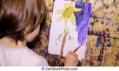 art painting - child painting  at paper with watercolor