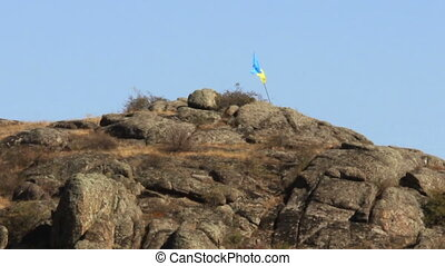 ukrainian flag in mountain - ukrainian flag at the Aktovskiy...