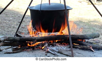 cauldron on campfire - close-up black cauldron on campfire
