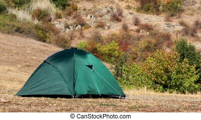 green tent at nature - close-up green tourist tent at wild...