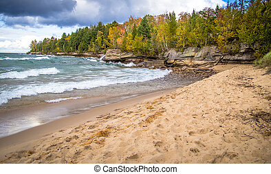 Autumn On Lake Superior Coast - Sandy beach leads to a wind...