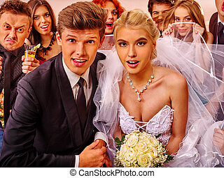 Bride and groom in photobooth. - Bride and groom in...
