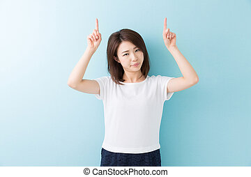 woman who points to the finger - young attractive asian...