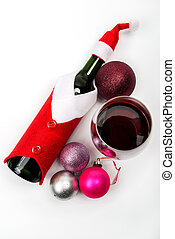 Wine bottle in Santa Clauss suit on a light background