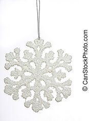 Snow flake - Close up shot of a fake snow flake set against...
