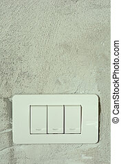 White switch on the wall background