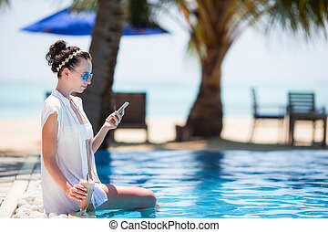 Beautiful young woman relaxing during tropical vacation on...
