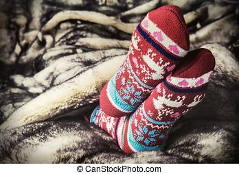 legs in Christmas socks