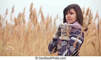 girl woman portrait in sweater scarf and mittens nature...