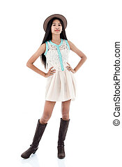 Portrait of Asian teenager fashion girl with long boots.