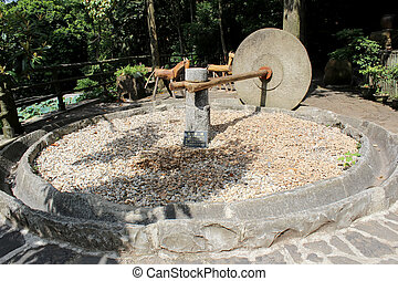 Old stone mortar for Rice processing in vietnam