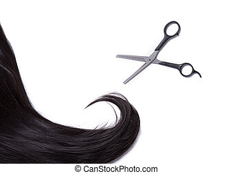 Black shiny hair strand with professional scissors