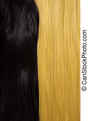 Texture of black and golden blond hair, soft focus