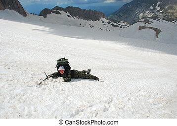 Tourist - The tourist slides on snow from mountain