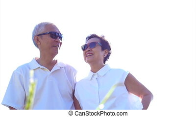Asian couple sunshine nature white - Cool Asian senior...